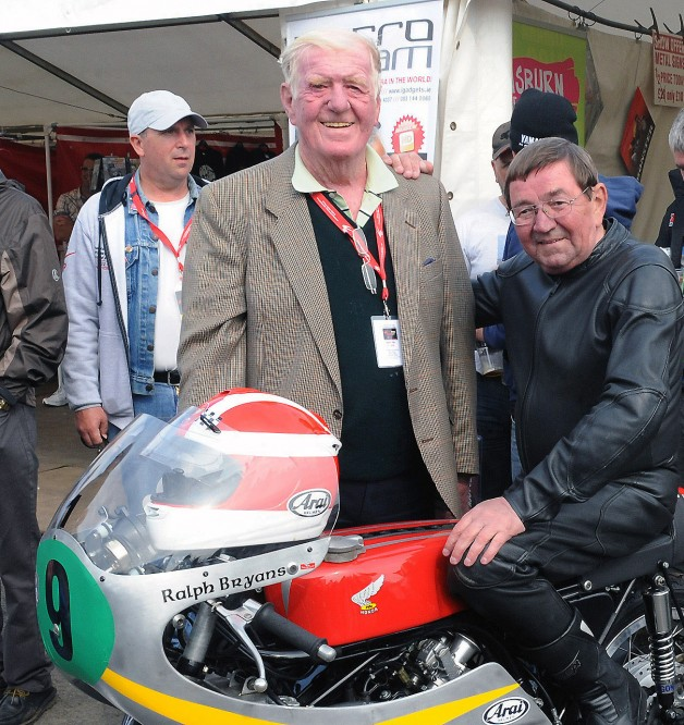 1965 World Champion rider Ralph Bryans, who died on Wednesday 6th August, is pictured in August 2012 prior to taking part in a Parade Lap of the famous Dundrod circuit, one of several events celebrating 90 years of the Ulster Grand Prix.  Included is Jim Lilley from Ballygowan, owner of the bike which Ralph rode in the 1960s.
