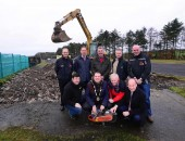The Dundrod & District Motorcycle Club has announced that construction work has officially begun on the new 'David Wood Ulster Grand Prix House' in the paddock at Dundrod, named after the well known road racer and team manager.    In a ceremony on Tuesday, 16th December, first ground was broken on the project that is to become the future home for the Ulster Grand Prix race office and will also be used for meeting rooms and commentator posts.   Pictured (back row, l-r): Ken Stewart, DDMC, Warren Bell, representing the Alpha Programme, Robert Graham, Chairman of the DDMC, Melvin Waddell, Groundwork NI and Noel Johnston, Clerk of the course at the Metzeler Ulster Grand Prix.  (Front row, l-r): James Courtney, President of the DDMC, The Mayor of Lisburn City Council, Councillor Andrew Ewing, Des Stewart, Chairman of the Ulster Grand Prix supporters Club and the BBC's Stephen Watson.